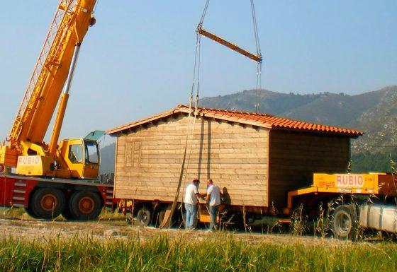 Traslado y montaje de casa de madera con separador